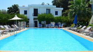 2 outdoor pools, open 8 AM to 8 PM, pool umbrellas, pool loungers