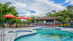 Outdoor pool, open 10:00 AM to 10:30 PM, pool umbrellas