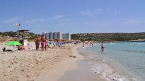 Beach nearby, white sand, 3 beach bars