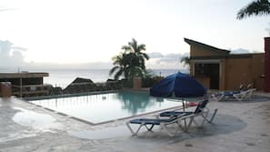 Outdoor pool, open 8 AM to 4 PM, pool umbrellas, sun loungers