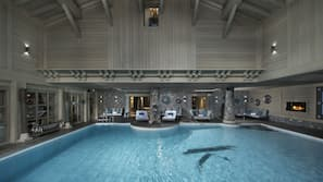 Indoor pool, open 8 AM to 9 PM, pool loungers