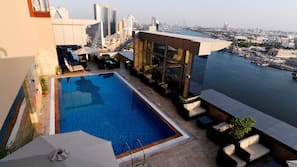 Outdoor pool, open 7:00 AM to 6:30 PM, pool umbrellas, sun loungers