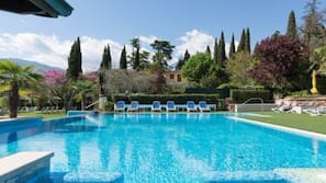 Outdoor pool, open 8:30 AM to 6:30 PM, pool umbrellas, pool loungers