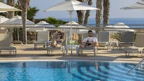 2 outdoor pools, open 8:30 AM to 6:30 PM, pool umbrellas, pool loungers