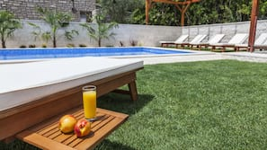 Outdoor pool, open 8:00 AM to 9:00 PM, free pool cabanas, pool loungers