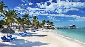 Private beach, white sand, free beach cabanas, sun-loungers