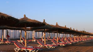 Private beach, sun loungers, beach umbrellas, beach bar