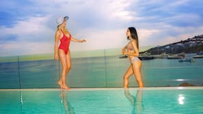 Outdoor pool, open 9:00 AM to 9 PM, pool umbrellas, pool loungers