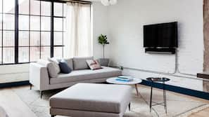 55-inch flat-screen TV with cable channels, iPad, Netflix