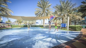 Outdoor pool, pool umbrellas, lifeguards on site