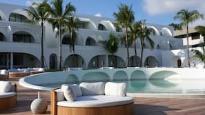 3 outdoor pools, open 7:30 AM to 7 PM, pool umbrellas, pool loungers