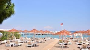 On the beach, free beach shuttle, beach cabanas, sun-loungers