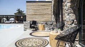 Seasonal outdoor pool, open 11:00 AM to 8:00 PM, free pool cabanas