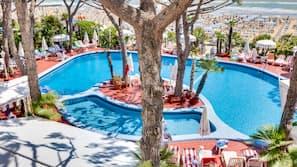 Seasonal outdoor pool, a rooftop pool, pool umbrellas, pool loungers