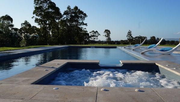 Seasonal outdoor pool, open 7 AM to 10:30 PM, pool umbrellas