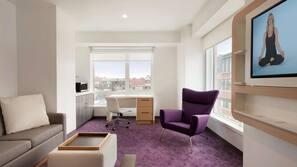 Premium bedding, memory foam beds, in-room safe, laptop workspace