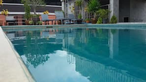 Outdoor pool, a rooftop pool, open 6:00 AM to 9:00 PM, sun loungers