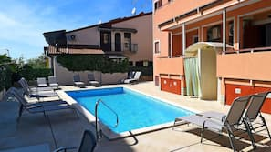 Seasonal outdoor pool, open 9:00 AM to 11:00 AM, sun loungers