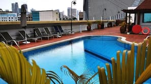 Outdoor pool, open 6:00 AM to 11:00 PM, pool loungers