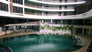 Indoor pool, open 9 AM to 10 PM, pool umbrellas, sun loungers