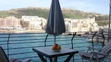 Marsalforn Seafront Apartment- 5 Star Holiday House - Zebbug Hotels