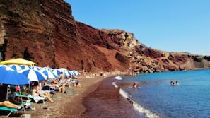 Beach nearby, black sand, sun-loungers, beach umbrellas