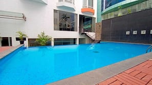 Indoor pool, outdoor pool, open 7:00 AM to 7:00 PM, pool umbrellas