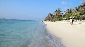 On the beach, white sand, beach towels, scuba diving