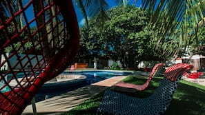 Outdoor pool, open 8 AM to 9 PM, free cabanas, pool umbrellas