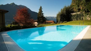 Seasonal outdoor pool, open 10:30 AM to 7:30 PM, sun loungers