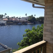 Top Level Canal Water Front Home With Boat Dock & Extra Parking!