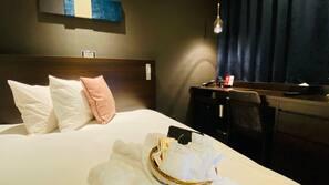 Premium bedding, down duvets, in-room safe, desk