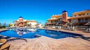 A heated pool, pool loungers
