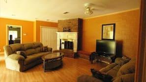 Flat-screen TV, fireplace, DVD player, stereo