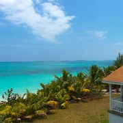 Secluded and Quiet Water-front Home With its own Private Beach + CAR Rental
