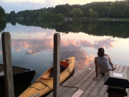 Great Place to stay Cottage by the Lake. HOT Tub, Private Dock, Kayaks near Red Hook