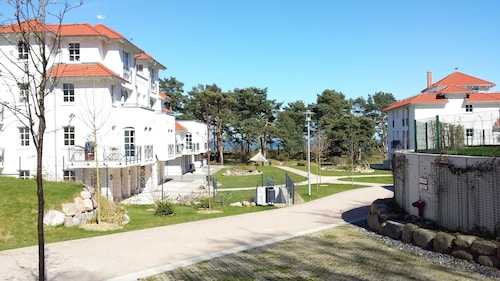 Modern Vacation Apartments Right by the Beach / Pool / Sauna / Wlan / Underground Garage Included