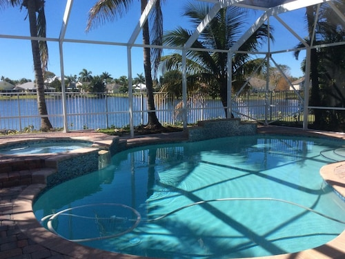 Great Place to stay Beautiful and Secure 4-bedroom Villa With a Private Pool and Lake Views near Jensen Beach