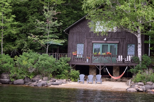 Classic ADK Boathouse On The Shore Of Long Lake