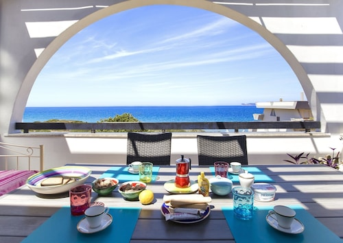 Alghero on the sea. Penthouse with incredible view and covered verandas for 9 people