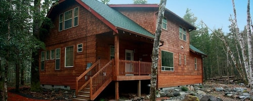 Great Place to stay Gorgeous Mt Hood Log Home on Sandy River,hot Tub,wifi,pets Welcome near Brightwood