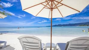 On the beach, white sand, beach umbrellas