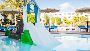 Outdoor pool, open 10:00 AM to 6:00 PM, pool umbrellas, pool loungers