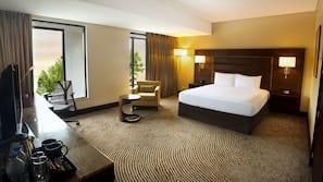 Premium bedding, in-room safe, laptop workspace, soundproofing