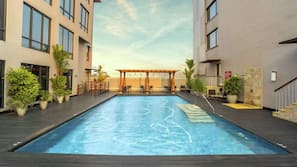 Outdoor pool, open 9:00 AM to 10:00 PM, pool umbrellas, pool loungers