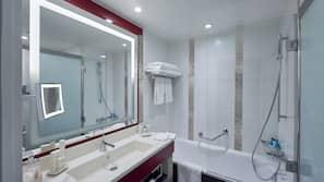 Combined shower/bathtub, free toiletries, hair dryer, bathrobes