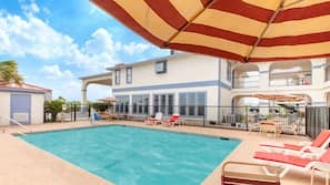 Outdoor pool, open 9:00 AM to 11:00 PM, pool umbrellas, sun loungers