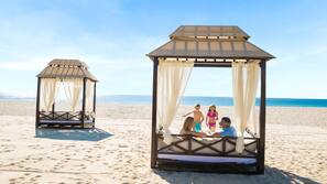 On the beach, beach cabanas, sun-loungers, beach umbrellas