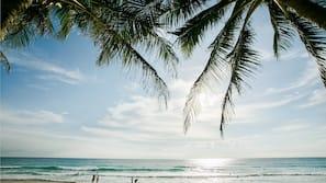 Beach nearby, white sand, beach towels, beach bar