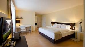 Premium bedding, down comforters, pillowtop beds, minibar